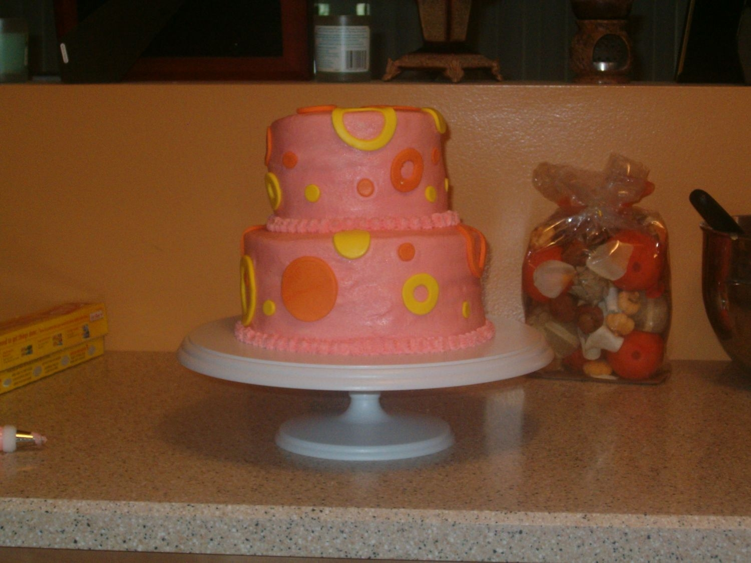 Pink, Orange, And Yellow Dots   Birthday cake for my 12 year old. Butter Pecan cake with butter pecan filling, buttercream and fondant accents.