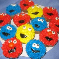 Sesame_Character_Cupcakes.jpg My first attempt at Sesame Street Character Cupcakes. Saw another CCer's and thought I'd give them a try. Hope you don't...