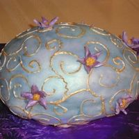 Easter Egg This is the top view of an easter cake which was baked in an egg shaped mold. I painted the fondant with blue luster dust, and painted the...
