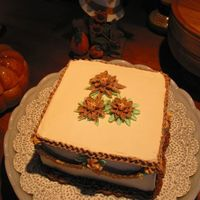 Trio Of Autumn Flowers This was one of two small cakes I made for a thanksgiving party at my relative's house.