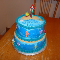 Ariel Little Mermaid Birthday Cake  Ariel birthday cake. Buttercream with Disney figures and sugar shells and sealife from Partyworks. Thanks to tyty for the inspiration and...