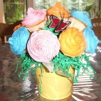 "Cupcake_Bouquet_001.jpg First attempt at a CC bouquet. 4"" pot using 12 mini CC....should have used at least 14, but didn't make enough ...lesson learned..."