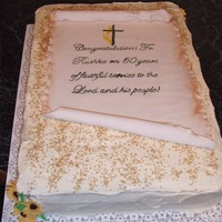 Priest 50Th Anniversary Cake carrot cake iced with crusting cream cheese icing. Gumpaste flowers on corners & parchment scroll done with gumpaste and antiqued with...
