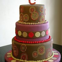 Mod Circular Wedding Cake  This is a dummy cake I made inspired by aboriginal art and some table linens I found. All fondant and royal icing. It was fun to make, and...