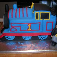 Thomas Side View   This is the side of the cake showing the Fat Controller, or Sir Topham Hatt. He was about 7 inches tall and was made from fondant.