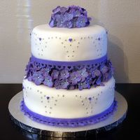 Purple Romance  This is a test cake for a wedding cake I am doing. I wanted made the flowers early, and I wanted to test some more scratch recipes, so I...