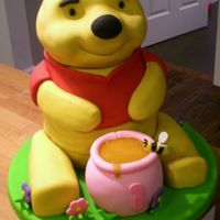Winnie The Pooh Cake  For my daughter's 1st birthday. Vanilla pound cake with strawberry filling and buttercream covered in fondant. It was 12 inches tall...