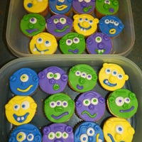 Monster Cupcakes Saw an idea for these here, thanks so much. The kids at my son's school loved these. MMF faces, vanilla cupcakes with purple jello...