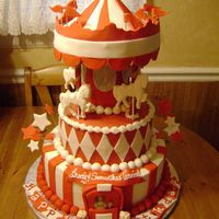 Carousel Cake Customer requested a red and white themed carousel cake. Everything is edible except for the 4 dowels.