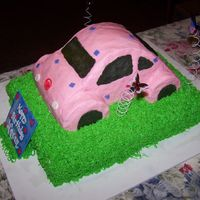 Pink Vw Bug This is a red velvet sheet cake cover with green cream cheese icing to be the grass. The VW Bug is yellow cake covered with pink...