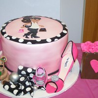 Mod Mom African-american cake for mom to be who loves shoes, shopping, etc. Enjoy! Everything in the picture is edible.