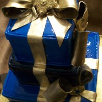 Stacked Gift Boxes Stacked gift boxes w/ gold bows, brooch made of fondant