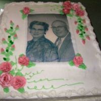 118710099058349.jpg This is my contribution to our 46th annual family reunion. I decided to add a pic of my Grandparents to liven the festivities. All icing is...