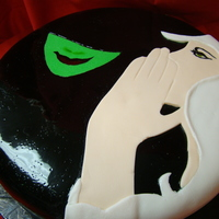 "Wicked Wicked poster image wrapped around 10"" cake. fondant over fondant and hand painted"