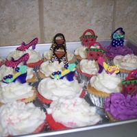 Bratz Cupcakes Here are the cupcakes I made to go with the bratz cake. The picture isn't the greatest. But I got the pic idea from someone else on...