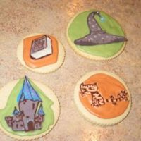 "Castle, Spell Book, Wizard Hat, And Cat Cookies I made these cookies based on the book, ""The Wizard, The Ugly, and The Book of Shame"" for a birthday gift. I thought it was a..."
