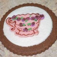 Textured Teacups These are for my mom's birthday. I rolled a doily over the fondant to give the background texture and then did a chocolate transfer...