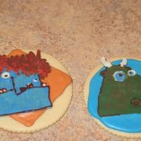 "Ogre And Dragon Cookies These cookies are based on characters in the book, ""The Wizard, The Ugly, and the Book of Shame"". The book is a present for our..."