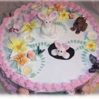 Spring Theme Child Birthday My clients daughter wanted a cake with a bunny, dog, butterflies and a spring theme. Fondant bunnies and dog and edible butterflies and...