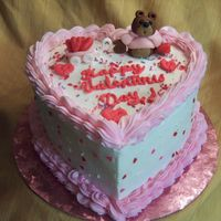 Hearts For My Valentine .... Heart shape yellow cake with BC icing. Sculpted bear, wagon and hearts from fondant. Royal icing lettering.