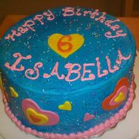Rainbow Heart Cake Buttercream with Fondant hearts. The birthday girl requested the sprinkles.