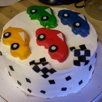 Racing Cake i've never done anything like this one before! i usually just stick to flowers! yellow cake with buttercream. i made extra cake and...