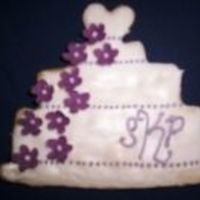 Wedding Cake Cookie sugar cookie with royal icing and fondant cut-out flowers