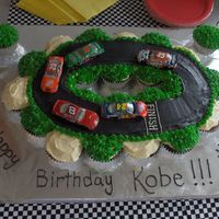 Nascar Birthday Cupcakes My son insisted on having his cake loaded with cars. I used cupcakes smothered in icing to create the track.