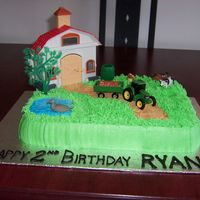 Farm Birthday Cake  I made this cake for my cousin's little boy who was turning two. Her son is infatuated with farms, John Deere tractors and holstein...