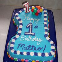 Number One Birthday Cake I made this cake for my son's first birthday. Chocolate cake covered in buttercream. Smarties around the base. He loved it and made a...