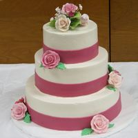 Pink And Fuschia Wedding Cake Swiss buttercream with fondant ribbons and gumpaste roses.