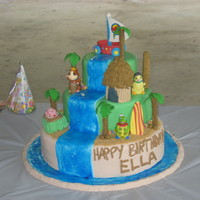 "Hawaiian Wonderpets Cake The characters are plastic figures. All other pieces, including the ""flyboat"" are gumpaste."
