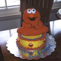 Elmo Cake For Emily This was an early cake for my daughter's 2nd birthday. Just the 3D bear pan with the ears cut off.