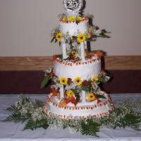 25Th Anniversary Cake My parents renewed their vowels in autumn so we used fall colors. Both of my grandmothers helped. : ) Oh and the flowers are real