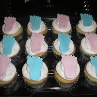 Cupcakes Cupcakes made for a fundraiser at work for M of D. Baby feet are made of fondant.TFL