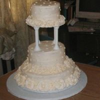 Antique White Wedding Butter Cream on Yellow layers. Made for older couple .