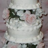 Jeanette's Wedding Cake is a rich yellow cake made the day before it was decorated with buttercream frosting.
