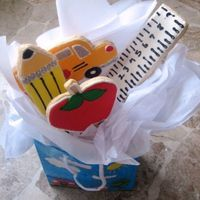 Back To School Bus, Ruler, Apple, Pencil   Bouquet i made for my friend's son for his first day of kindergarden! Royal icing. No fail sugar cookie recipe