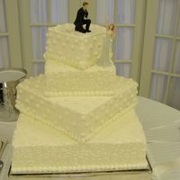 Off Set Square Bride wanted cake square, diamond, square, diamond even though cake didn't sit completely on top of layer underneath. Very unusual,...