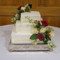 Adrianne Wedding Cake square wedding cake bc icing, ribbons and flowers