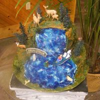 Field & Stream 2 layer, camo looking icing, all buttercream, with piping gel tinted blue for the water. Fishing and deer hunting, a mans true paradise!!