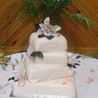 Shan B Cake square, mmf icing, scrolls, ribbons and calla lillys