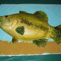 Largemouth Bass This was my first time using MMF, using luster dusts, sculpting and painting on a cake. I think it went okay but the MMF started to crack...