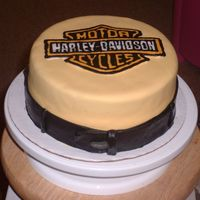 Harley Davidson Harley Davidson cake made with chocolate cake, coverd in MMF, with a FBCT. Belt also made of MMF.