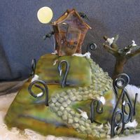 Spooky Shack Airbrushed fondant, gumpaste bats, moon, fence and tree.
