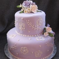 Anniversary Cake Client wanted lilac and flowers.