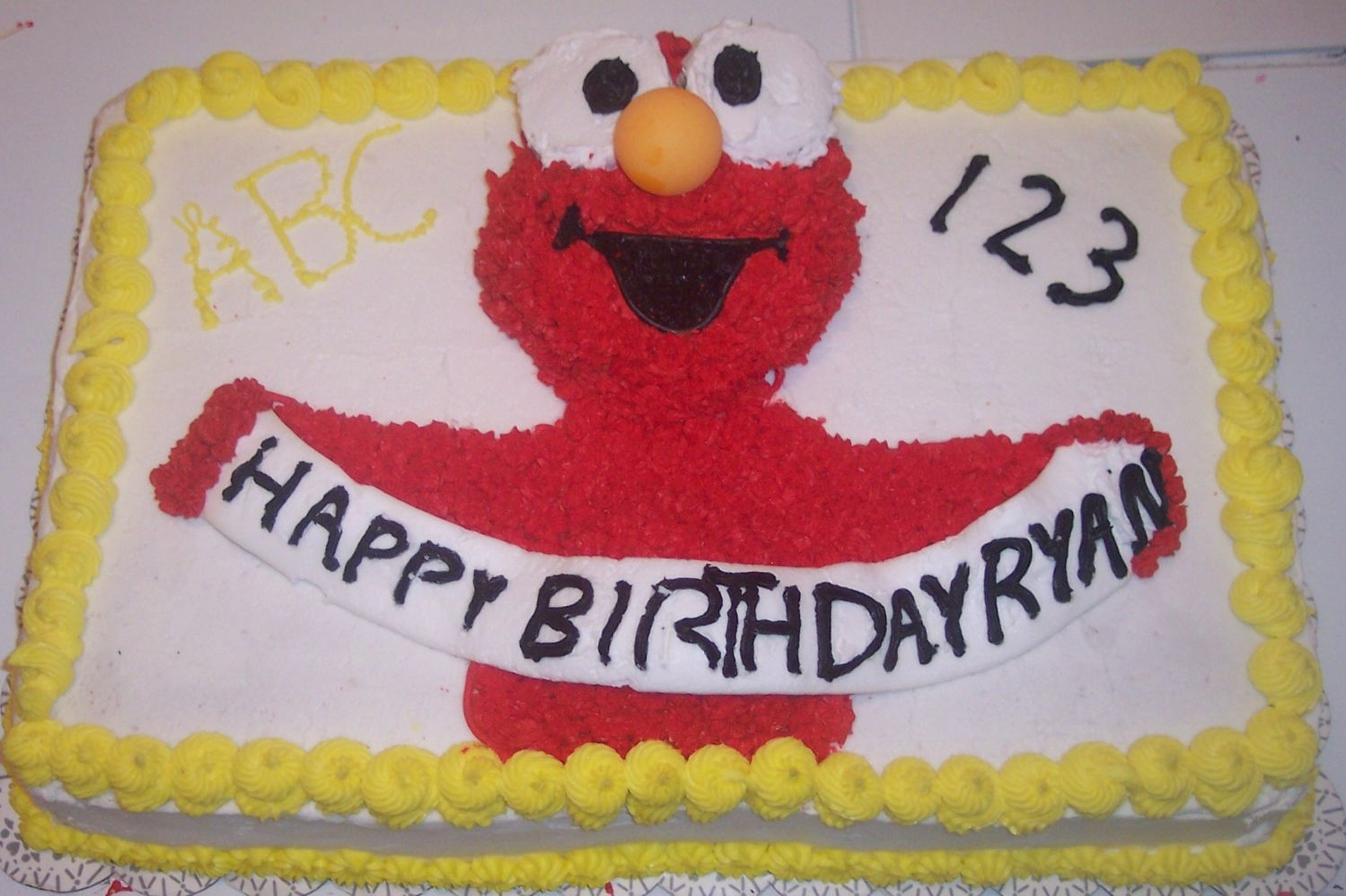 Elmo Birthday Cake This is an Elmo birthday cake done for my grandson Ryan's second birthday. It is a 2 layer cake, one layer golden, one chocolate. Just...
