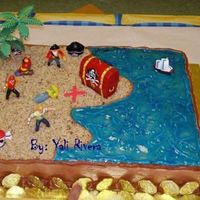 Pirates Pirate almond cake, 11 x 15 pan, all buttercream, coconut sand and blue piping gel for the sea.