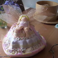 Judy Fairy  Heart shaped two tiered lemon and buttercream cakes with modelling paste * Fairy * and flowers,complete with intricate wings with pearl...