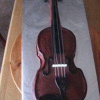 Violin Cake I did this cake for a young man in celebration of a concert. Marble cake covered in chocolate fondant with fondant accents.